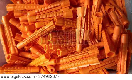 Close-up, A Small Bunch Of Orange-colored Construction Dowels
