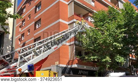Sabadell, Spain - 07/05/2020: Firefighters Acting To Verify Detachments On The Facade Of A Building