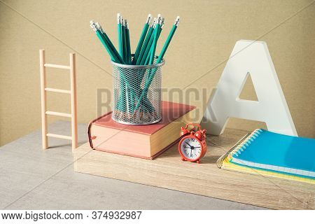 Back To School Creative Concept With Pencils, Books And Alarm Clock. Modern Still Life Composition