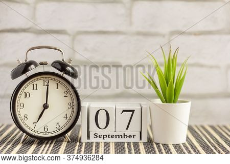 September 7 On A Wooden Calendar Next To The Alarm Clock.september Day, Empty Space For Text.calenda
