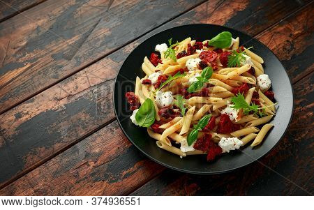 Chorizo, Penne Pasta With Creamy Ricotta Cheese On Plate