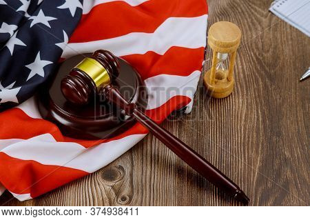 Hourglass Measuring The Us Judge Legal Office With Judges Gavel On American Flag Wooden Table