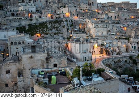 Matera; Italy - September 15; 2019: Evening View Of The City Of Matera; Italy; With The Colorful Lig