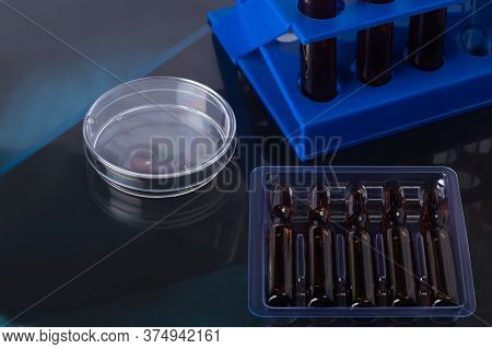 Laboratory Blood Tests And The Creation Of An Untested Vaccine, A Concept On A Dark Background