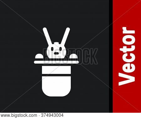White Magician Hat And Rabbit Icon Isolated On Black Background. Magic Trick. Mystery Entertainment