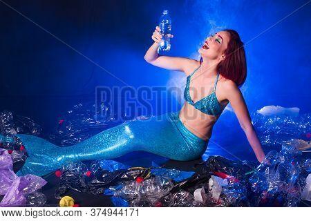 Ocean Plastic Pollution Concept. Mermaid Lives To Polluted Habitat.