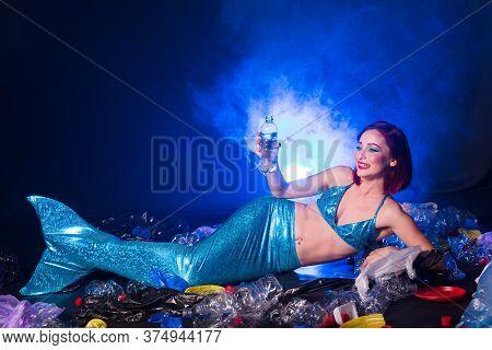 Ocean Plastic Pollution. Mermaid Have Fun In Water With Plastic Garbage. Stop Plastic Pollution. Fai