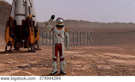 Astronaut Waving His Hand. Exploring Mission To Mars. Futuristic Colonization And Space Exploration