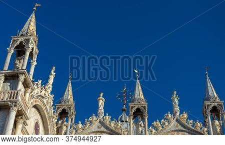 St Mark`s Basilica Or San Marco, Detail Of Facade Top On Blue Sky Background, Venice, Italy. Famous
