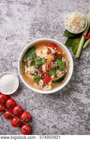 Top View Food And Drink, Traditional Thai Cuisine. Tom Yam Kung, Tom Yum Sour Soup With Shrimp, Praw