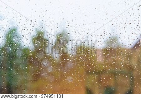 Water Droplets On A Window. Blurry Blue And Green Background. Picture From Scania, Southern Sweden