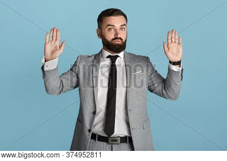 Office Executive In Formalwear Showing Surrender Gesture Against Blue Background