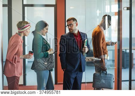 Side View Portrait Of Business People Standing In Line In Office, Focus On Mature Bearded Businessma