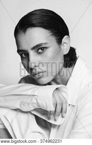 Vintage style black and white portrait of young beautiful tomboy