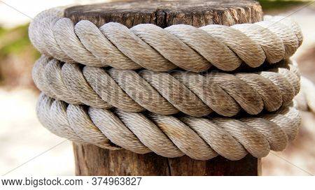 Mooring rope at the pier. Thick mooring rope