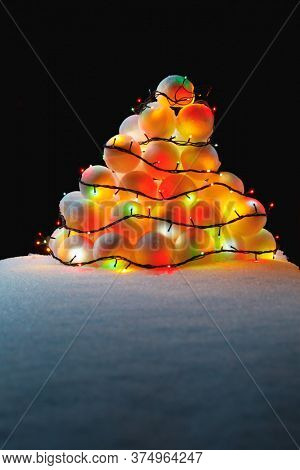 christmas tree lights on snowballs heap