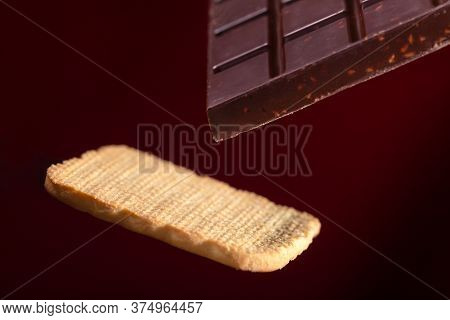 A Bar Of Chocolate And Cookies On A Brown Background With A Gradient
