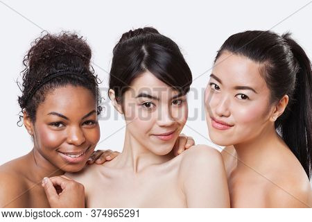 Beauty portrait of young multi-ethnic women over white background