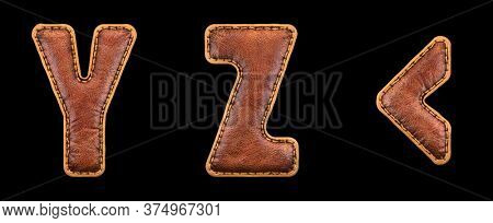 Set of leather letters Y, Z and symbol left angle bracket uppercase. 3D render font with skin texture isolated on black background. 3d rendering