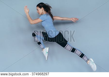 Fitness Woman Working Out At Home, Jumping And Running, Doing Intense Exercises