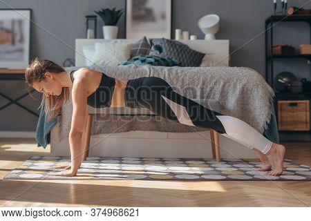 Full Plank. Fitness Woman Exercising At Home.