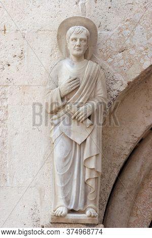 ZADAR, CROATIA - AUGUST 11, 2013: Saint, statue on the portal Cathedral of St Anastasia in Zadar, Croatia