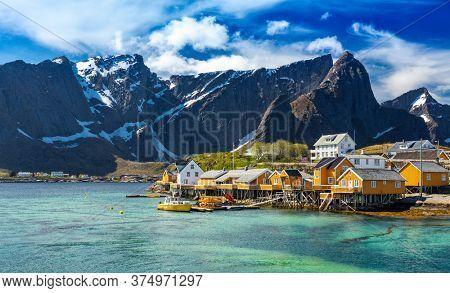 Fishing hut (rorbu) in the Hamnoy and  In Background - Sakrisoy (Sakrisoya) Reine, Hamnoy, Moskenes, Lofoten islands, Norway