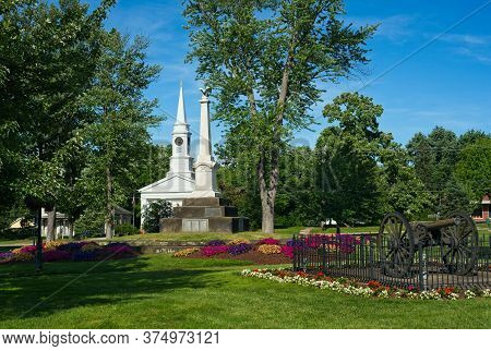 Summer Flowers Grace The Township Square In Twinsburg, Ohio, With Civil War Cannon, Monument, And A