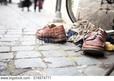 Urban Street Composition. Pair Of Brown Leather Boots With White Shoelaces, Light Beige Pullover On