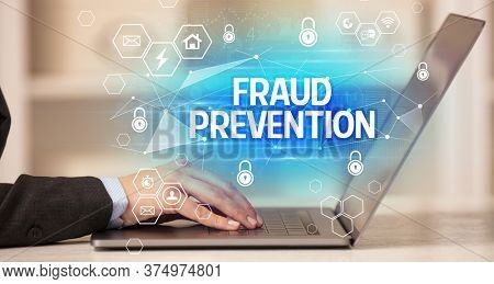 FRAUD PREVENTION inscription on laptop, internet security and data protection concept, blockchain and cybersecurity