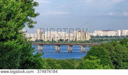 Kiev, Ukraine - June, 2013: View Of The Paton Bridge And The Left-bank Neighborhoods Of The Kiev, Uk