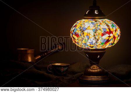 Turkish Cafe Illuminated By Turkish Lamp On Wooden Table
