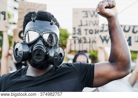 Activist Wearing Gas Mask Protesting Against Racism And Fighting For Equality - Black Lives Matter D