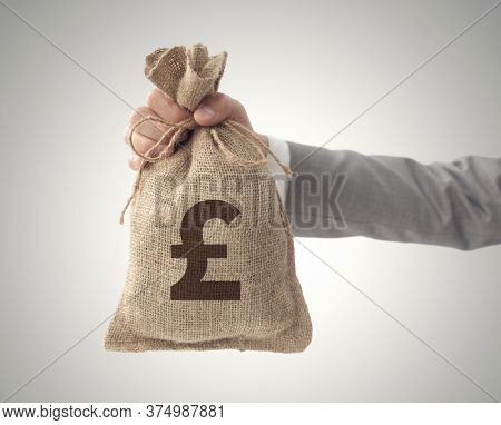 Money bag with Pound sign business man holding outstretched