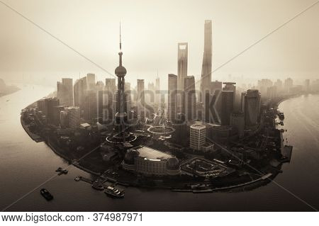 Shanghai city aerial view with Pudong business district and skyline in China.