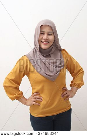 Successfull Happy Asian Muslim Woman Wearing Hijab Smiling Friendly With Hands On Hips, Confident St