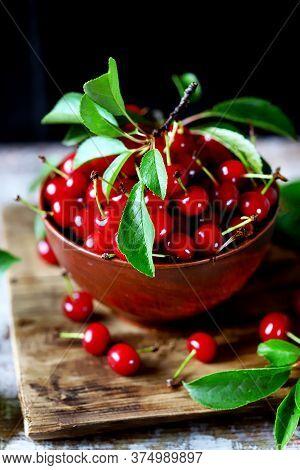 Selective Focus. Red Cherries With Leaves In A Bowl. Harvest Cherries. Scarlet Cherries.