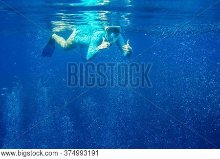 Woman In Full Face Snorkeling Mask Underwater Photo. Female Snorkel Show Thumb Undersea. Snorkeling