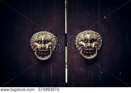Lion door handle in Xiahao Old street in Chongqing, China.