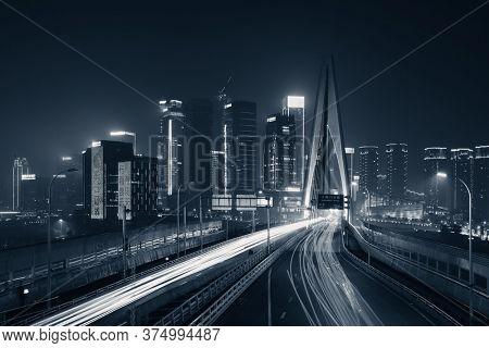 Bridge and light trail at night in Chongqing, China.