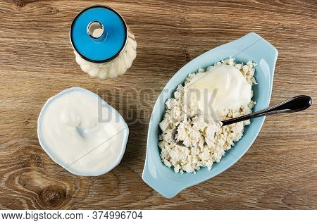 Sugar Bowl, Bowl With Sour Cream, Metallic Spoon In Blue Oval Bowl With Grainy Cottage Cheese On Woo
