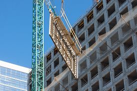 Construction Of A Building, Crane Lifts Reinforcement For Floors And Walls Of A Multi-storey Buildin