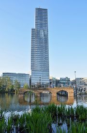 Landscape View Of The Old Roman Bridge In The Lake, Behind Which Stands A Glass Building. Cologne. G