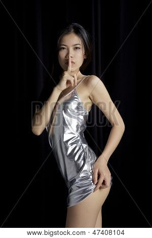 Asian Girl showing quiet sign