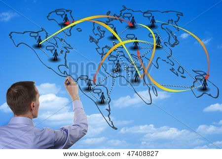 Man Drawing On A World Map On A Glass Wall