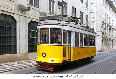 Typical Yellow Tram On The Street Of Lisbon