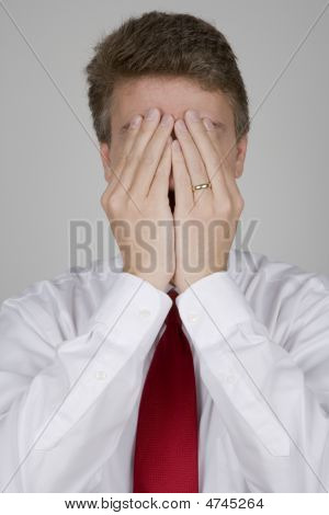 Business Man Hiding His Face