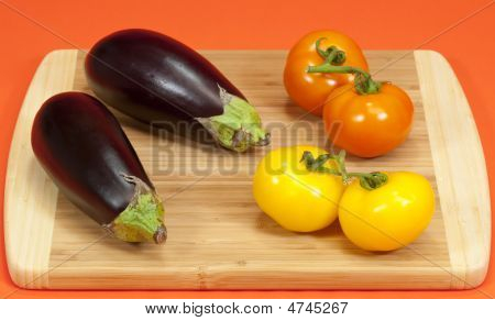 Fresh Eggplant And Tomatoes