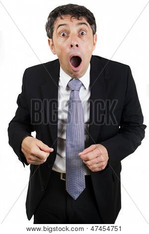 Businessman reacting in shocked horror or utter amazement standing with his mouth open, isolated on white