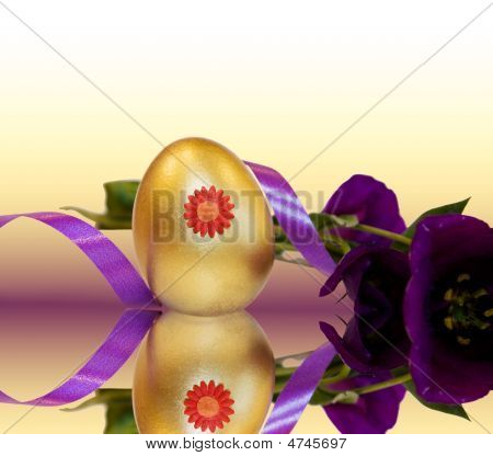 Easter Golden Egg With Purple Ribbons And Reflections